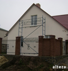 Photo of the insulation outside the facade of a private residential cottage on Chervon Shlyakh in Poltava by employees of the Alteza construction company-1.