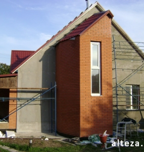 Photo of the insulation outside the facade of a private residential cottage on Chervon Shlyakh in Poltava by employees of the Alteza construction company-5.