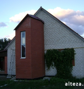 Photo of the insulation outside the facade of a private residential cottage on Chervon Shlyakh in Poltava by employees of the Alteza construction company-6.