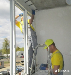 Photo of installation of metal-plastic windows in a multi-storey building by employees of the Alteza construction company-14.