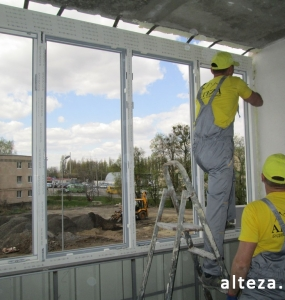 Photo of installation of metal-plastic windows in a multi-storey building by employees of the Alteza construction company-16.