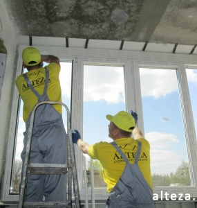 Photo of installation of metal-plastic windows in a multi-storey building by employees of the Alteza construction company-5.