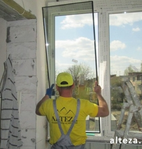 Photo of installation of metal-plastic windows in a multi-storey building by employees of the Alteza construction company-7.