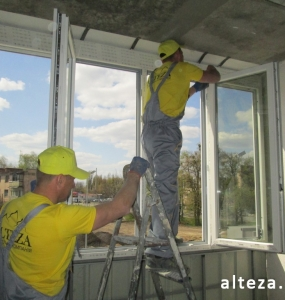 Photo of installation of metal-plastic windows in a multi-storey building by employees of the Alteza construction company-8.