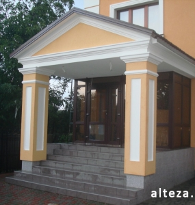 Photo insulation of the facade of the house outside on the street. L.Ukrainka in Poltava by employees of the construction company Alteza-7.
