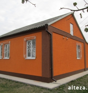 Photo insulation of the facade of the cottage outside in with. Krotenki Poltava region employees of the construction company Alteza-3.