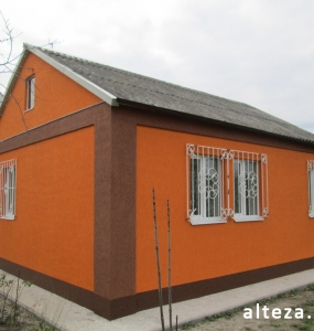 Photo insulation of the facade of the cottage outside in with. Krotenki Poltava region employees of the construction company Alteza-4.