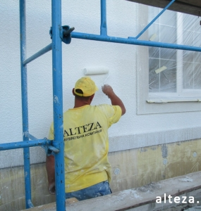 Photo of a private house insulation outside in with. Yareski Poltava region employees of the construction company Alteza-1.