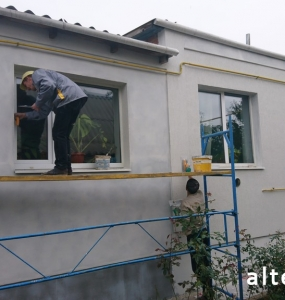 Photo of a private house insulation outside in with. Zaliznychny Poltava region employees of the construction company Alteza-1.