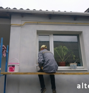 Photo of a private house insulation outside in with. Zaliznychny Poltava region employees of the construction company Alteza-2.
