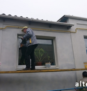 Photo of a private house insulation outside in with. Zaliznychny Poltava region employees of the construction company Alteza-3.