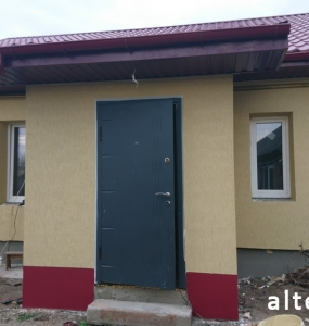 Photo insulation of the facade of a private house outside in with. Zentsy Poltava region employees of the construction company Alteza-3.