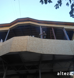 Photo of insulation outside the extension of a residential cottage in Poltava by employees of the Alteza construction company-2.