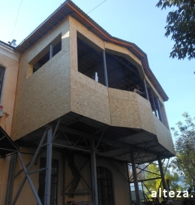 Photo of insulation outside the extension of a residential cottage in Poltava by employees of the Alteza construction company-3.