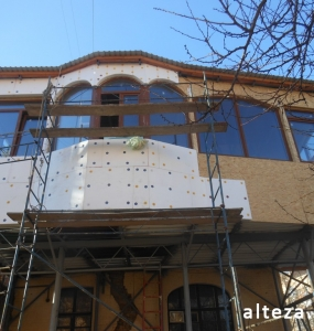Photo of insulation outside the extension of a residential cottage in Poltava by employees of the Alteza construction company-4.