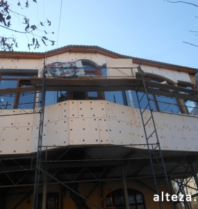 Photo of insulation outside the extension of a residential cottage in Poltava by employees of the Alteza construction company-5.
