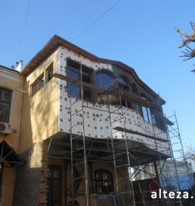 Photo of insulation outside the extension of a residential cottage in Poltava by employees of the Alteza construction company-6.