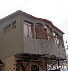 Photo of insulation outside the extension of a residential cottage in Poltava by employees of the Alteza construction company-8.