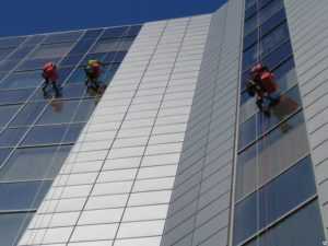 three high-level installers perform cleaning services of the facade